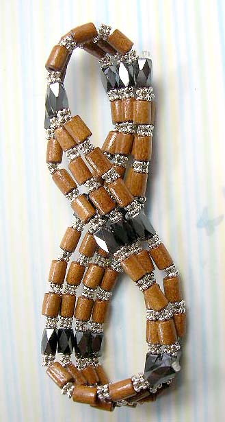 Shop for magnetic hematite jewelry online wholesale - multi light brown wood tubes and silver beads forming magnetic hematite necklace